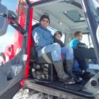 Sitting in between his father Troy Pope (left) and Snow Farm manager Sam Lee is the winner of the...