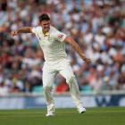 Australia's Mitchell Marsh celebrates taking the wicket of England's Sam Curran. Photo: Reuters