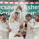 Captain Tim Paine holds up the Ashes urn as Australia celebrate following the final test. Photo:...