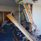 A building has been extensively damaged after a car crashed into a Linwood Ave building. Photo:...