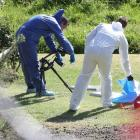 Police forensic officers pictured during the investigation into the homicide of a 59-year-old...