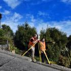 Dunedin surveyors Dylan Hills (left) and Toby Stoff start creating a super-accurate model of...