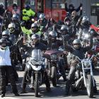 About 70 women motorcyclists gather at a North Dunedin service station to refuel and regroup...