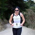 Cavy Dolphins team member Celia Lie contests the second leg of the Peninsula Relay on Saturday,...