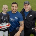 Mason Ratten, 8, with his heroes, All Blacks Codie Taylor and Jack Goodhue. PHOTO;Geoff Slaon