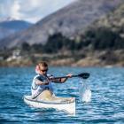 Peak to Peak winner Hamish Fleming paddles on Lake Wakatipu on Saturday. PHOTO: SEAN BEALE