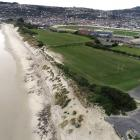 An aerial photograph shows the steep scarp, rocks and other rubble left behind after erosion at...