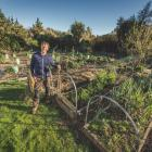 Ben Elms with some of his own raised beds fitted with hoops. Photo: Si Williams.