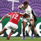 England's Anthony Watson in action with Tonga's Cooper Vuna. Photo: Reuters