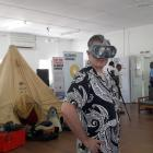 New Zealand's High Commissioner to Fiji, Jonathan Curr, uses a virtual reality headset at an...