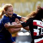 Trisha Hopcroft, of Otago Spirit, fends off Waikohika Flesher, of Counties-Manukau, during a...