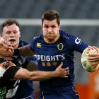 Otago captain Michael Collins fends off Brad Weber on the way to his side's win over Hawke's Bay...
