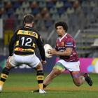 Southland centre Isaac Te Tamaki prepares to step past his Taranaki opposite, Tei Waldon during...