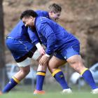Otago prop Hisa Sasagi (right) thumps into team-mate Louis Conradie during a training session at...