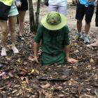 A guide lowers himself into the Cu Chi Tunnels. Photo: Supplied.