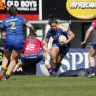 Otago Spirit midfielder Kilisitina Moata'ane runs at Tasman defender Bethan Manners during their...