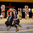 Rebecca Parnham and artist Simone Johnstone in front of the Unity sign.