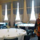 Oamaru Licensing Trust general manager Cathy Maaka walks through the Brydone Hotel's dining room,...