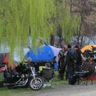 Under the trees at Parsons Rock, about 700 motorcycle riders sort out their campsites late on...
