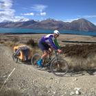 Dunedin cyclist Johnny Van Leeuwen, with dog Hugo in tow, reach the high point of the Alps 2...