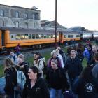 Tenth International Penguin Conference delegates depart from a Dunedin Railways train at Oamaru...