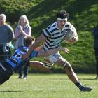 Otago Boys' High School No8 Taylor Dale goes in to score in the tackle of Nelson  College...
