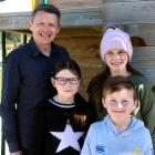 New Duntroon School principal Mike Turner with his children Ruby (9, left), Hazel (11), and...