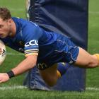 Otago replacement winger Henry Purdy dives over to score in yesterday's Ranfurly Shield win over...