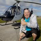 Paul Matheson in front of Christchurch City Helicopters modern Guimbal Cabri G2 helicopter before...