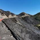 Heat from the fire left more than 200m of guardrails on Porters Pass buckled and lying on the...
