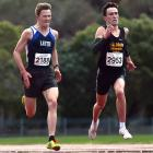 Oli Chignell (right) reaches the finish line ahead of Janus Staufenberg at the Otago 3000m track...