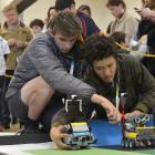 Queenstown Robo Stormers Club members and Wakatipu High School pupils Jasper Cusiel (left) and...
