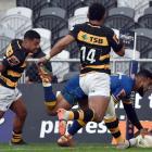 Otago winger Jona Nareki gets past taranaki players (from left) Te Toiroa Tahuriorangi and...