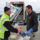 Agrecovery contractor Rodger Gregge (left), of Ashburton, collects chemical containers from Kuana...