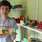 Dunedin speedcubing fan Isaac Latta (14) can solve a variety of puzzles at high speed. Photo:...