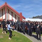 A haka and waiata are performed as a procession carrying former Ngai Tahu chief executive Tahu...