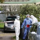 Investigators at the scene following the incident in Auckland. Photo: NZ Herald