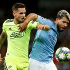 Manchester City's Sergio Aguero (R) in action with GNK Dinamo Zagreb's Petar Stojanovic. Photo:...
