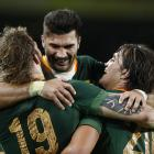 South African players celebrate a try against Italy. Photo: Reuters