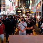 Anti-government protesters wear masks during a demonstration at Mong Kok after the ban on face...