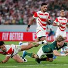 Faf de Klerk crosses the line in South Africa's win over Japan in the World Cup quarterfinals....