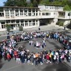 Arthur Street School pupils celebrate after learning their school has received $10.9 million from...