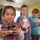 Vienna Apireru, 5, Asher Van Asperen, 7, and Ella Mead, 7, with the three types of angels made...