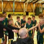 The Mid Canterbury U13 boys A grade team gets a team talk from coach Ben Ditmer ahead of their 89...