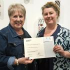 Departing gallery stalwart Anne Carr with art gallery committee vice-president Fleur Tompsett.
