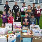 Hampstead School's Young Vinnies with some of the donated perishable goods, back row, Isope Maile...