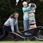 Karitane School pupils Alana Shaw (10) and Oscar Cadden (8) help unload books from a shipping...