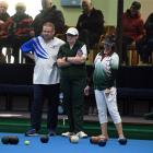 (from left) Regan Larkin and Sarah Ibbotson, and playing partner Tania Beattie, watch Andy McLean...