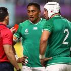 Referee Nic Berry holds up a red card to Ireland's Bundee Aki as captain Rory Best watches on....