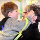 Dunedin Mayor-elect Aaron Hawkins is greeted by his son, Emile, at a victory party in a Dunedin...